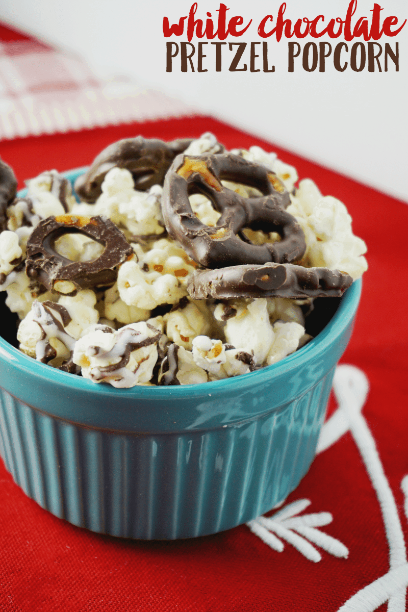 Make this delicious white chocolate pretzel popcorn with chocolate covered pretzels, white chocolate candy melts, and LOTS of buttery popcorn!