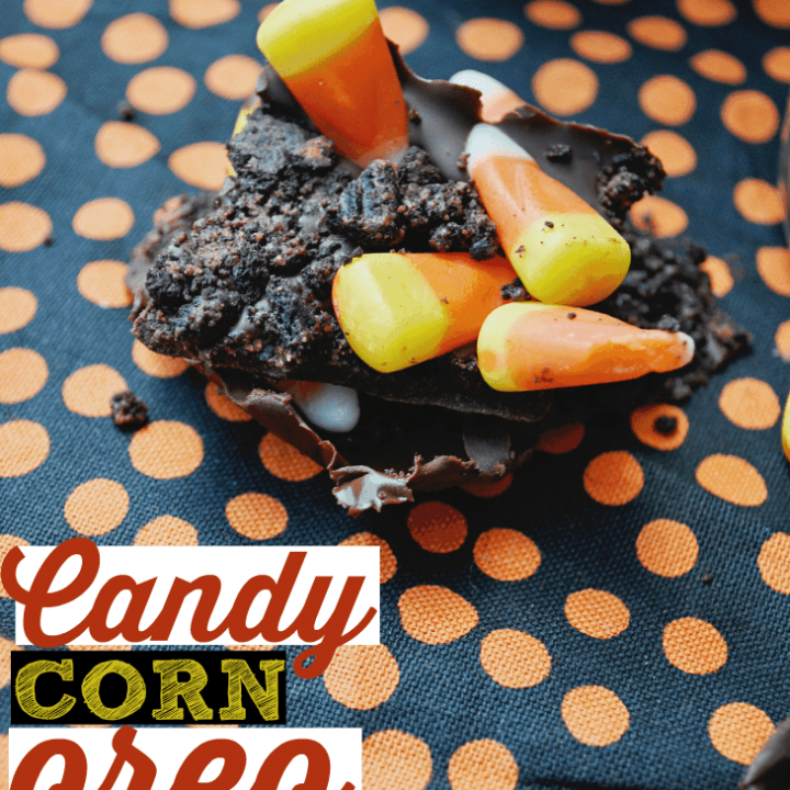 Need an easy Halloween treat idea? Melt chocolate chips, crush Oreos, and top with candy corn. This candy corn bark is the best!