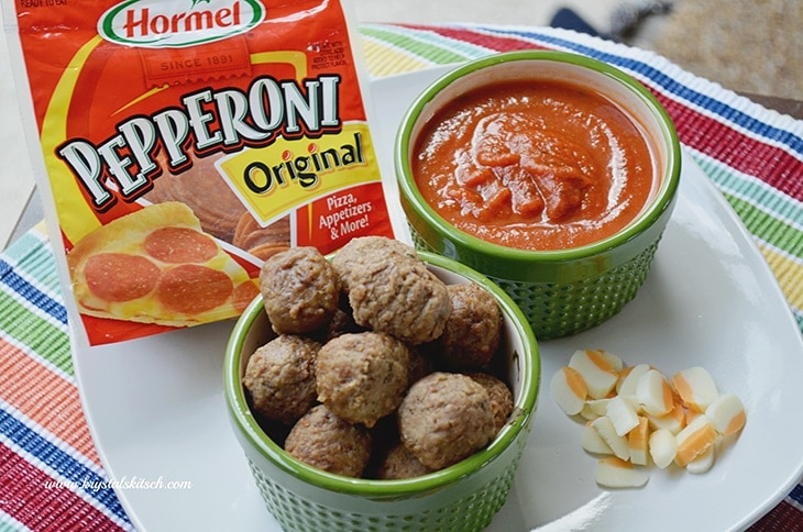 Pair pepperoni with mozzarella cheese and Italian meatballs for an easy party appetizer. Add homemade pizza sauce and enjoy a flavorful dish!