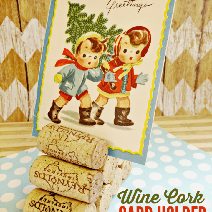 Make a wine cork card holder to display holiday cards on your mantle or as fun centerpieces!