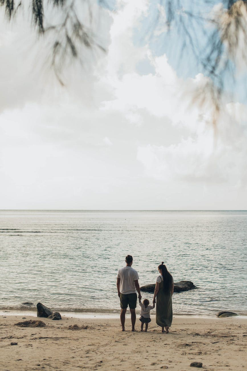 woman and man standing at shores