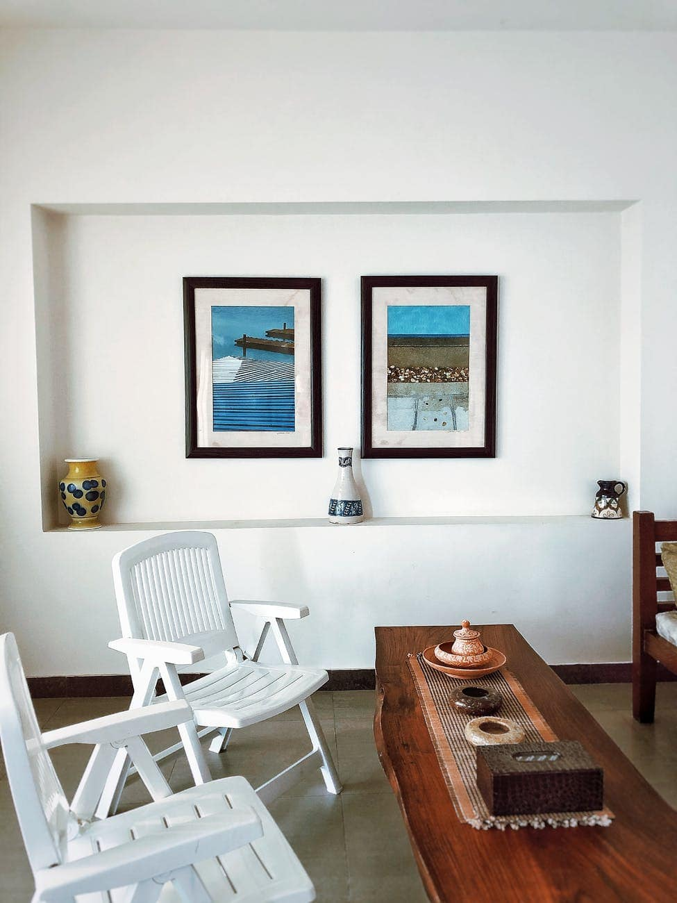 interior of dining room with chairs and pictures in frames