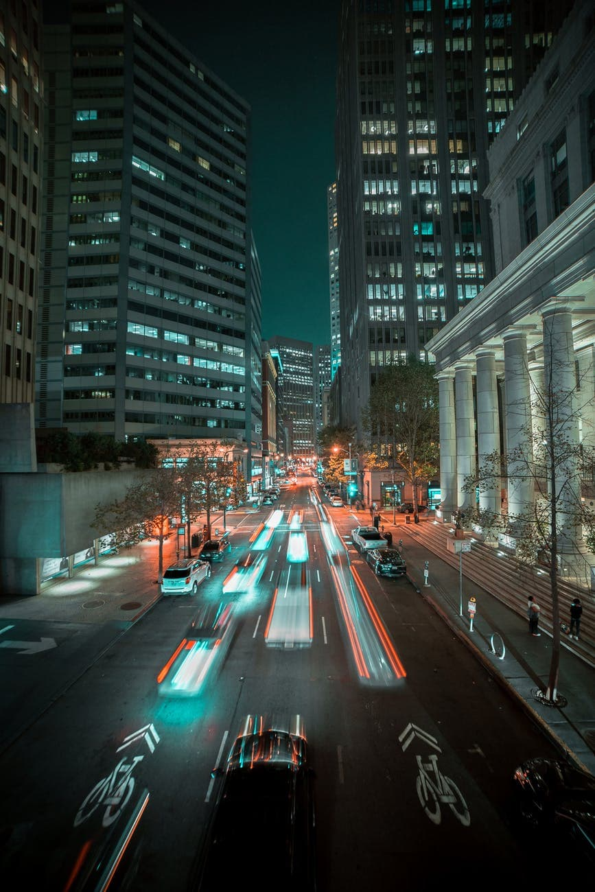 cars on road in city during night time