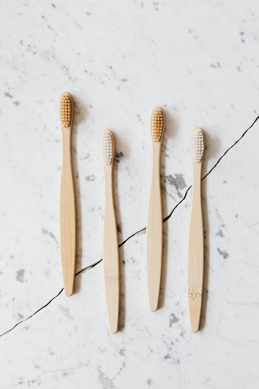brown wooden toothbrush on white background