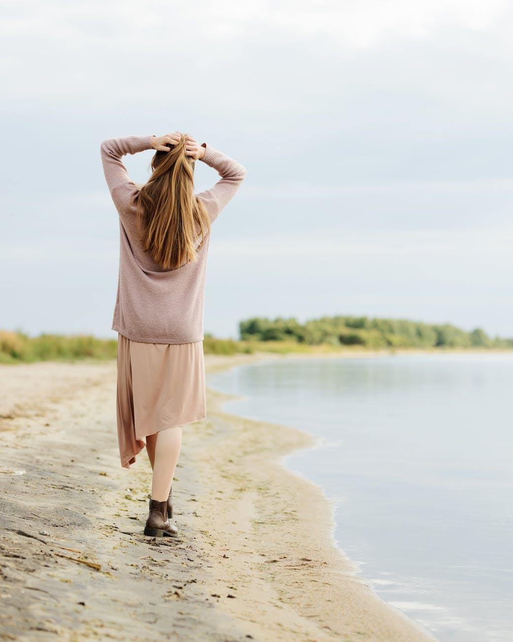 woman walking on a lakeshore