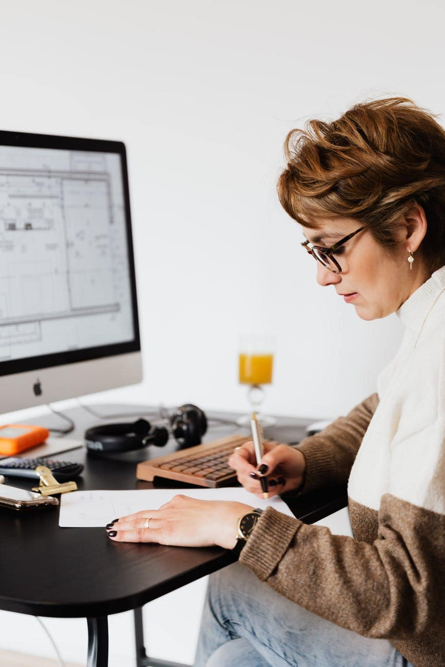 serious adult lady doing paperwork in modern office
