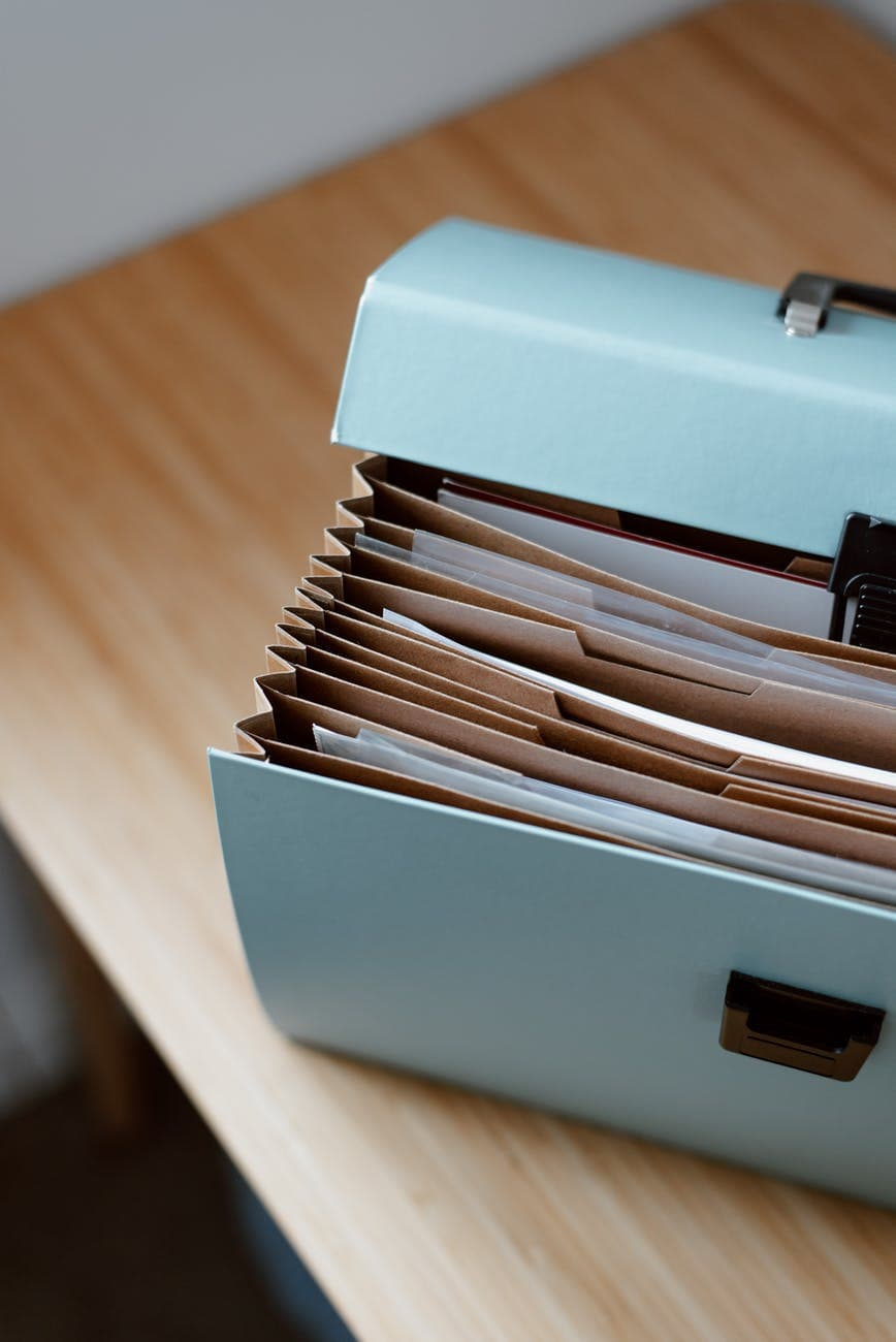 briefcase with documents placed on table