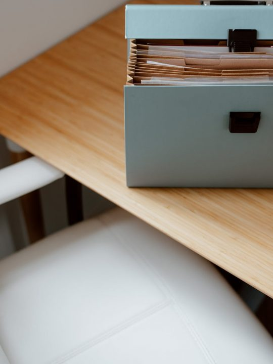 opened briefcase for documents placed on table