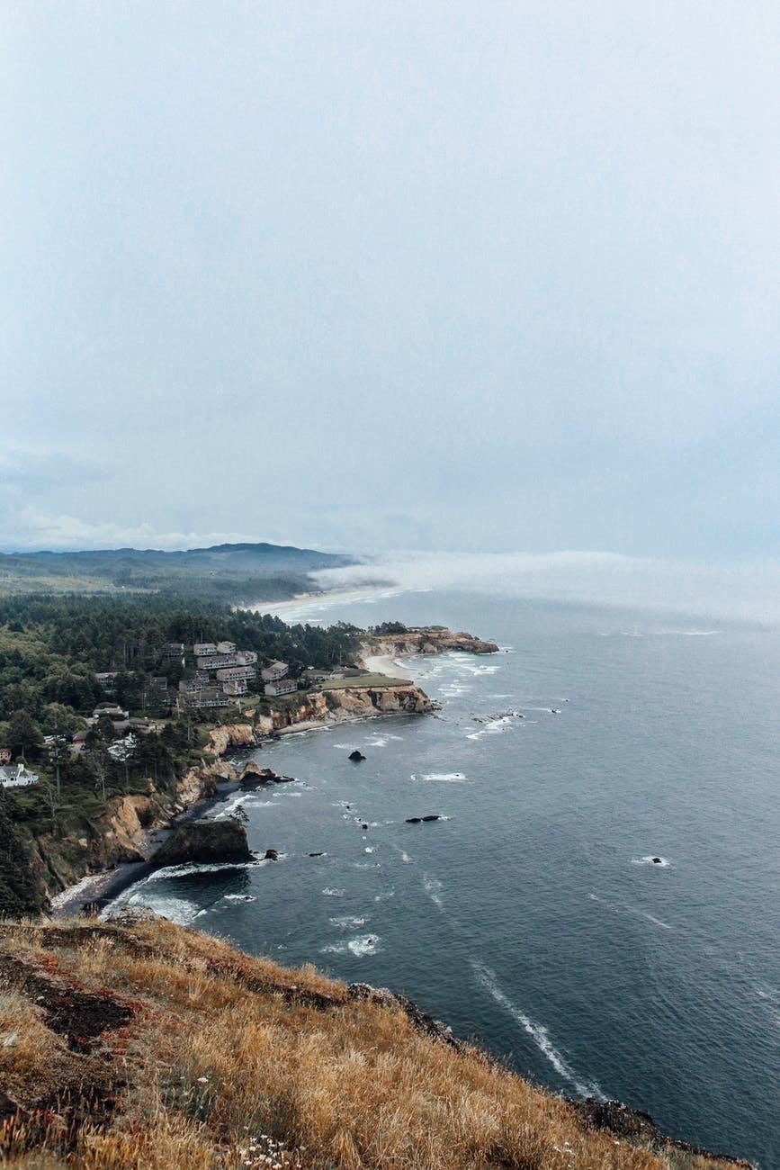 rocky coast of picturesque sea in sunlight