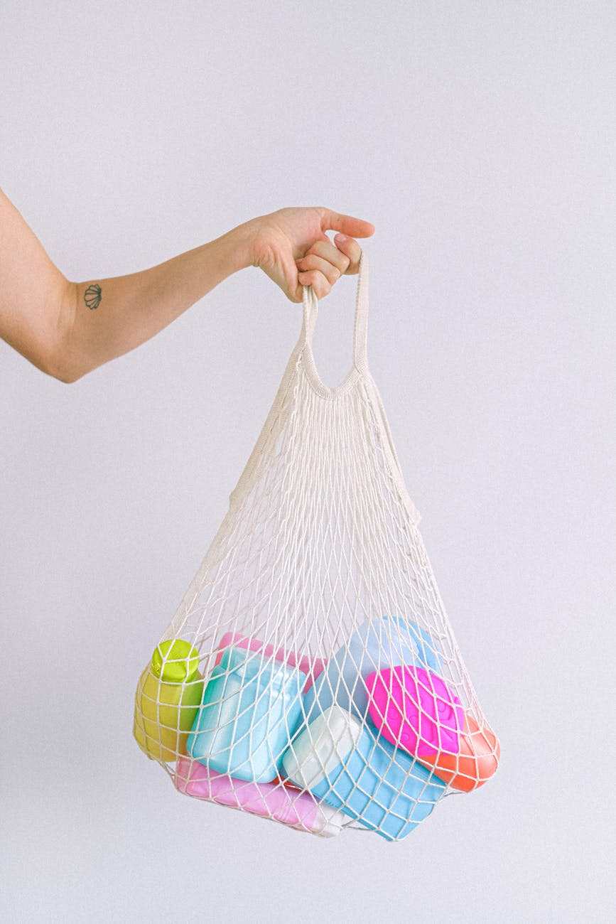 woman with string bag with plastic containers