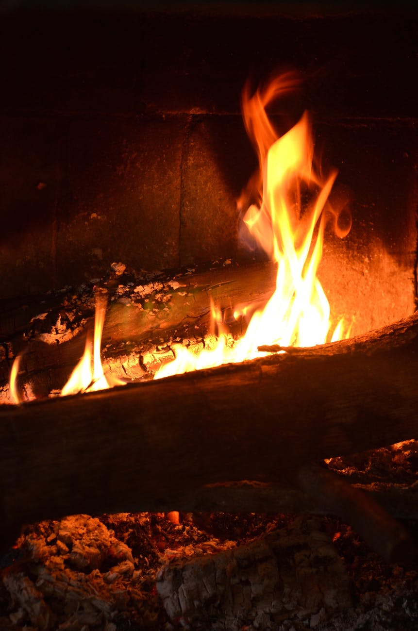 burning fireplace with cracking fire in darkness