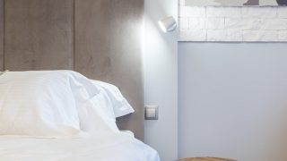 modern bedroom interior with shiny lamp against bed