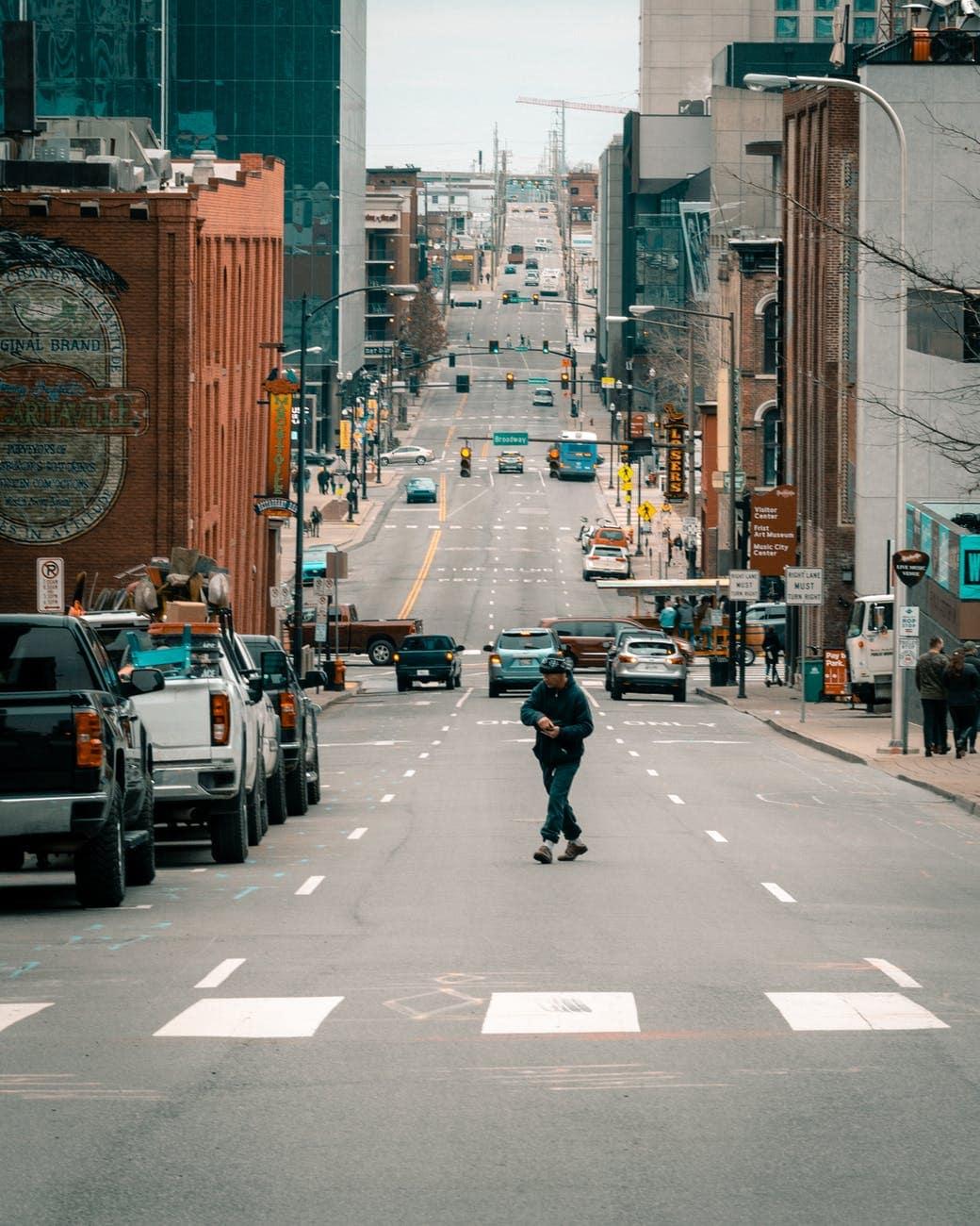 city crossing road traffic
