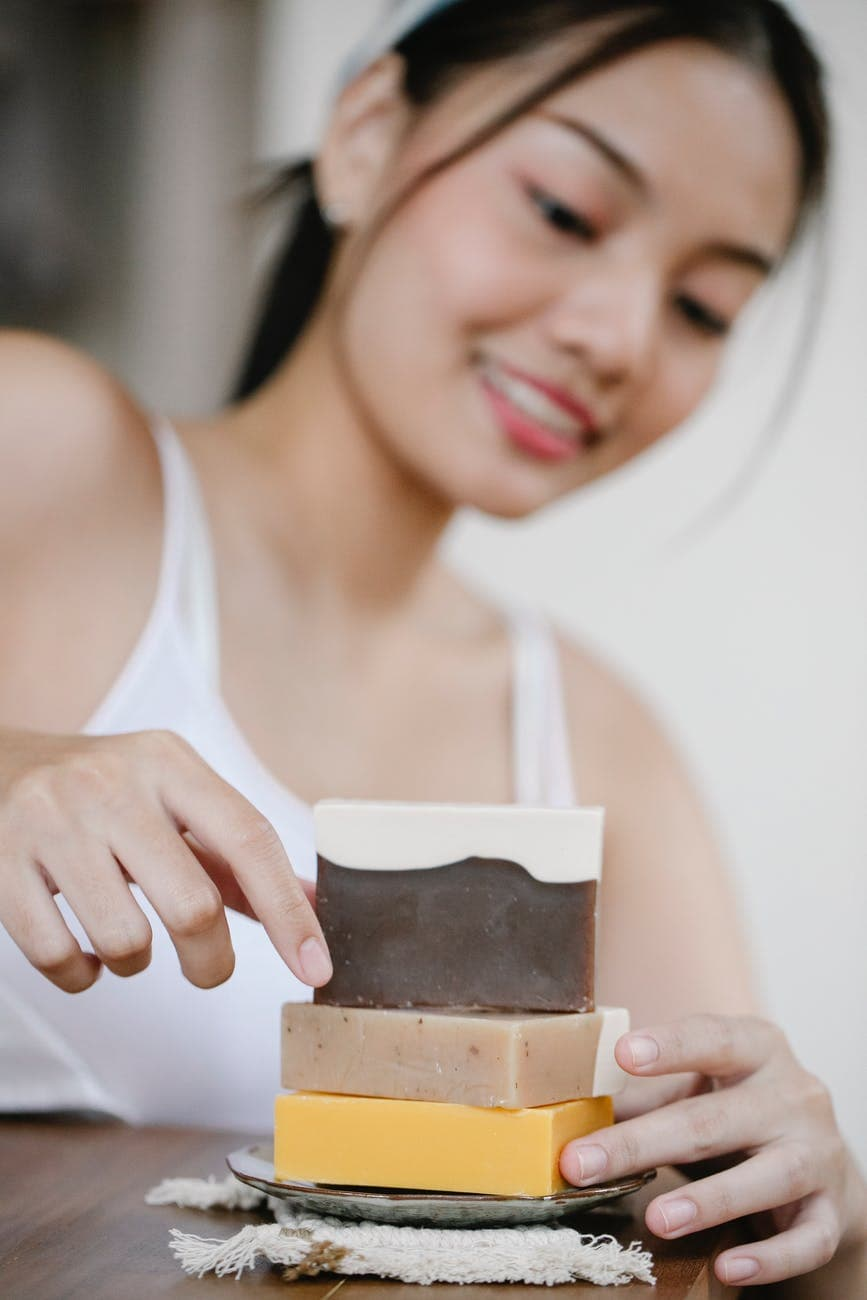 cheerful asian woman with eco soap