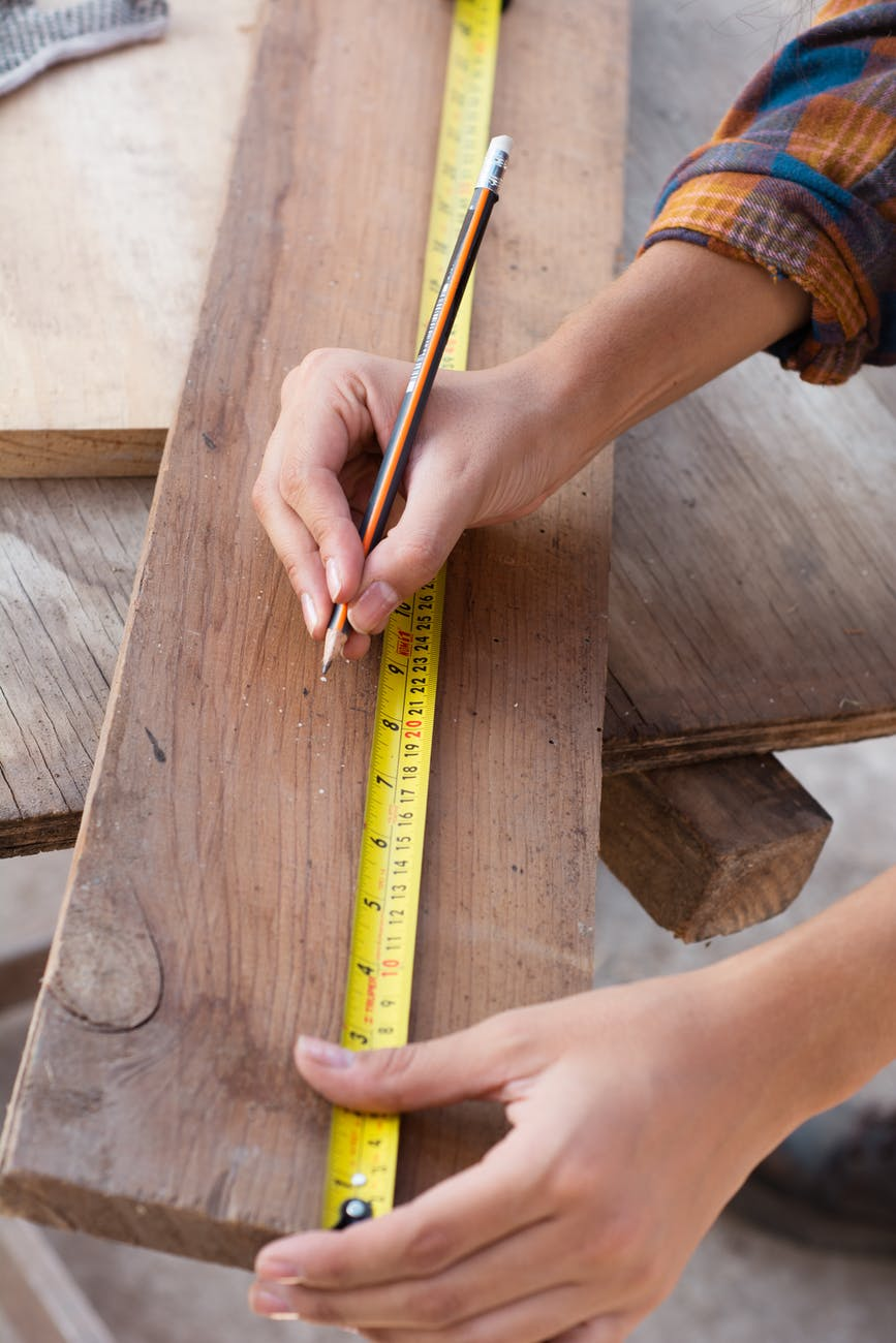 wood man woman construction